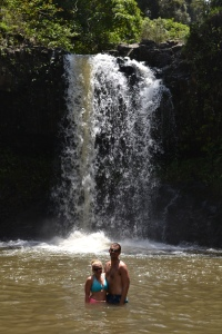 Swimming near waterfalls after a hike off the Road to Hana